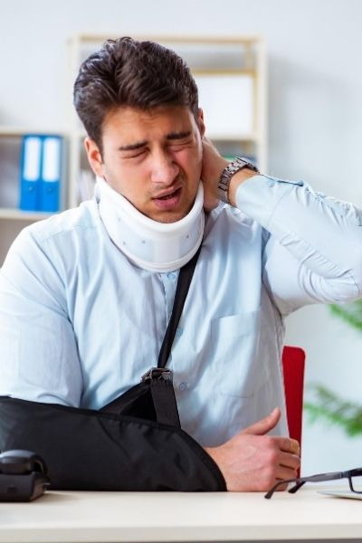 Car Crash Injury Lawyers   Man with injuries including a sore neck