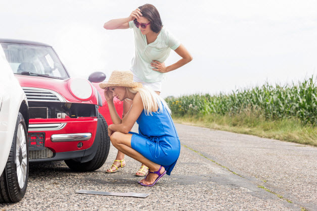 Car Accident Personal Injury Attorney | Tensed women looking at damaged cars